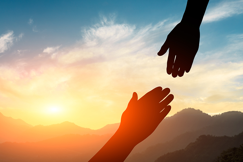 Helping Hands with Sky and Sunset